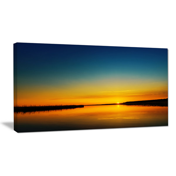 Designart Orange Sunset Over River Skyline Photography Canvas Art