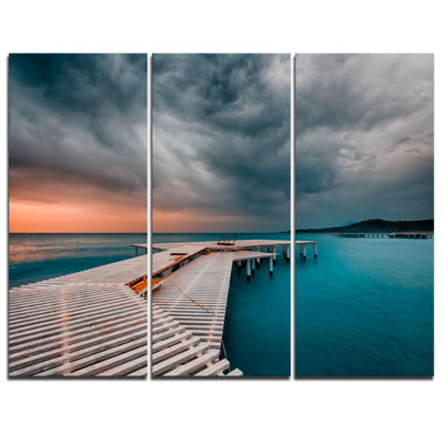Designart Pier In Ocean In Cloudy Day Seashore Photo Canvas Print - 3 Panels