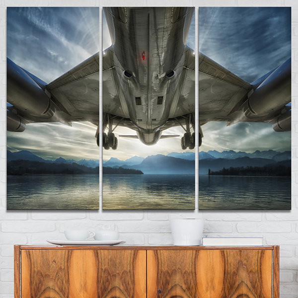 Designart Plane Over Beach And Sea Seashore Photography Canvas Print - 3 Panels