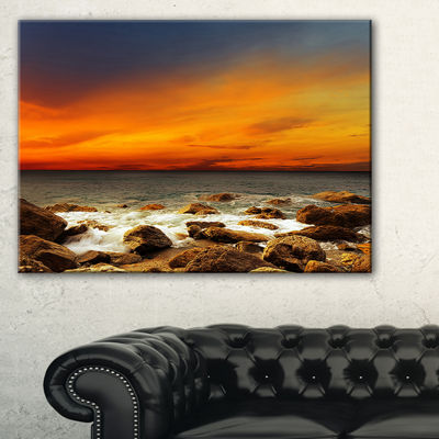 Designart Red Sky Over Rocky Seashore Beach Photography Canvas Print - 3 Panels