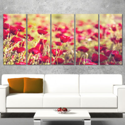Designart Large Yellow Flower in Spotlight Large Flower Canvas Art Print - 4 Panels
