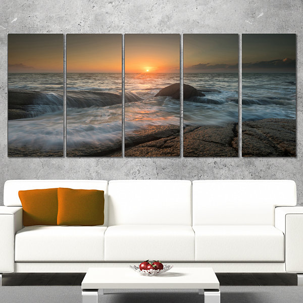 Designart Lashing Sea Waves At Sunset Beach PhotoCanvas Print - 5 Panels
