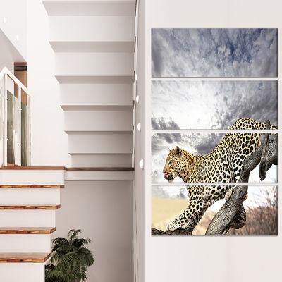 Designart Leopard Taking Rest on Tree Trunks ExtraLarge African Canvas Art Print - 4 Panels