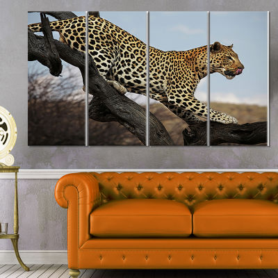 Designart Leopard Walking on Tree African Canvas Art Print -4 Panels