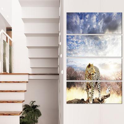 Designart Leopard Walking Under Cloudy Sky AfricanCanvas Art Print - 4 Panels