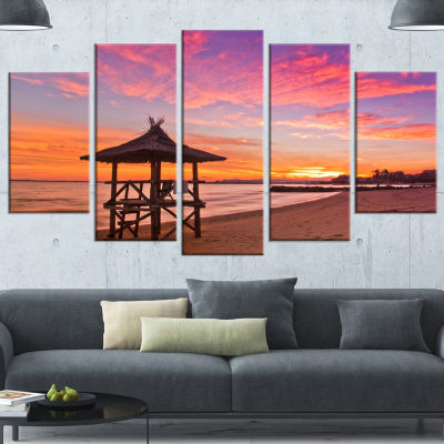 Designart Lifeguard Station in Beautiful Beach Modern Seashore Canvas Art - 4 Panels