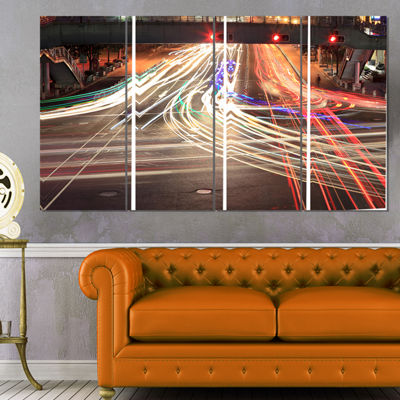 Designart Light Traces on Crossroad Cityscape Digital Art Canvas Print - 4 Panels