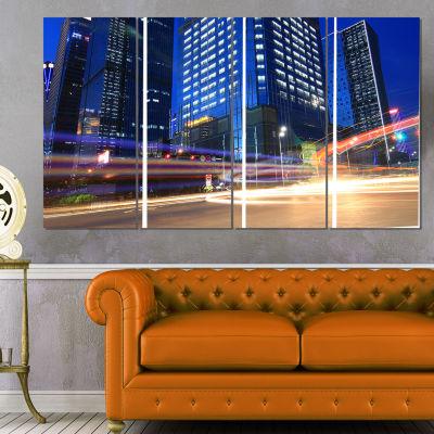 Designart Light Trails in Blue City Cityscape Digital Art Canvas Print - 4 Panels