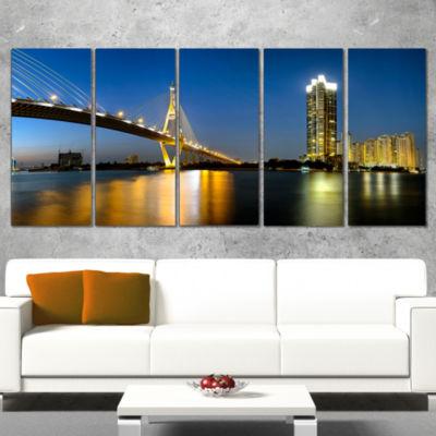 Designart Lit Up Bhumibol Bridge At Dusk CityscapeCanvas Art Print - 5 Panels