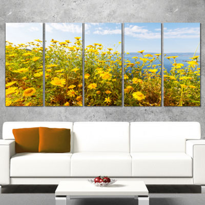 Designart Little Yellow Flowers Over Seashore Large Flower Canvas Art Print - 5 Panels