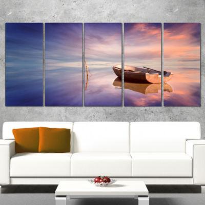 Designart Lonely Boat in Colorful Sea Seascape Canvas Art Print - 4 Panels