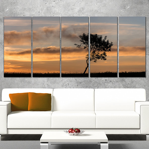 Designart Lonely Tree Silhouette Rightwards Landscape CanvasArt Print - 4 Panels
