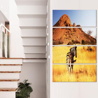 Designart Lonely Zebra in African Prairie AfricanCanvas ArtPrint - 4 Panels