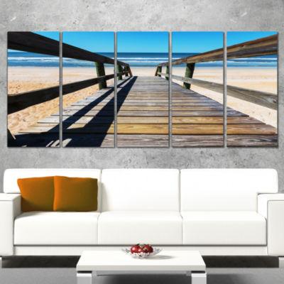 Designart Long Boardwalk into Blue Seashore Seashore WrappedCanvas Art Print - 5 Panels
