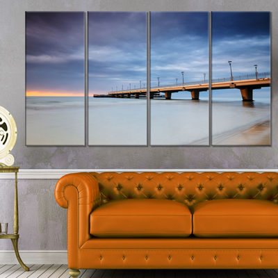 Designart Long Concrete Pier into Sea Sea Bridge Canvas ArtPrint - 4 Panels