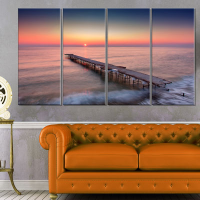 Designart Long Exposure Sea and Shore Sea Bridge Canvas ArtPrint - 4 Panels
