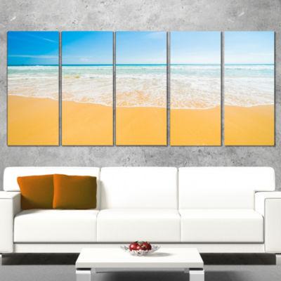 Designart Long Waves on Sand Under Blue Sky Seascape CanvasArt Print - 4 Panels