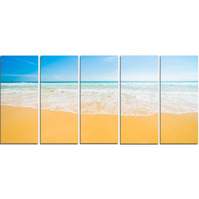 Designart Long Waves on Sand Under Blue Sky Seascape CanvasArt Print - 5 Panels