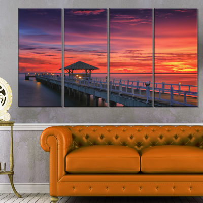 Designart Long Wooden Bridge and Colorful Sky SeaBridge Canvas Art Print - 4 Panels