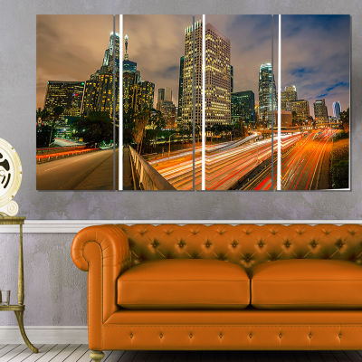Designart Los Angeles Yellow Skyline Night Cityscape CanvasPrint - 4 Panels