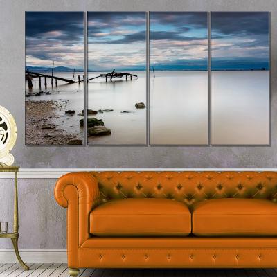 Designart Magic Sunrise With Old Wooden Pier PierSeascape Canvas Art Print - 4 Panels