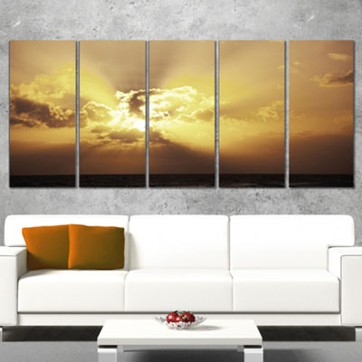 Designart Majestic Sea Sunset Through Clouds Landscape WallArt on Canvas - 5 Panels