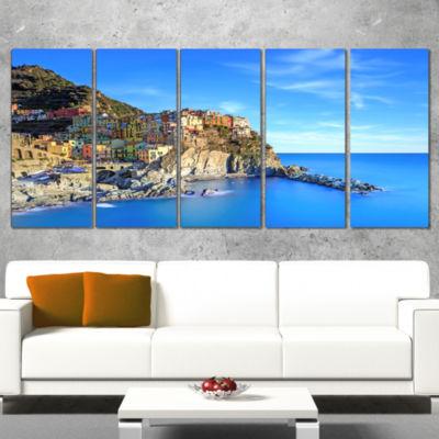 Designart Manarola Village in Rocks and Sea BeachPhoto Wrapped Canvas Print - 5 Panels