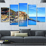 Designart Manarola Village in Rocks and Sea BeachPhoto Wrapped Canvas Print - 5 Panels