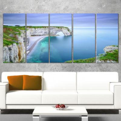 Designart Manneporte Natural Rock Arch Seashore Photo CanvasPrint - 4 Panels