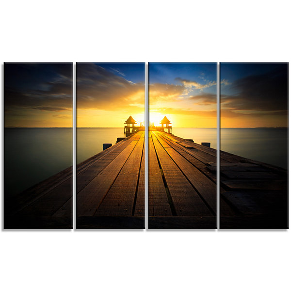 Designart Massive Wood Pier To Sun At Evening PierSeascapeCanvas Art Print - 4 Panels