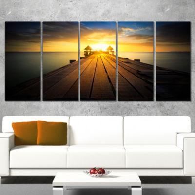 Designart Massive Wood Pier To Sun At Evening PierSeascapeWrapped Canvas Art Print - 5 Panels