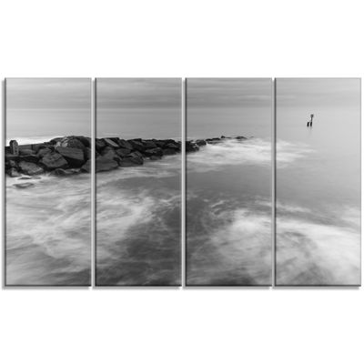 Designart Milky Waves Splashing Over Rocks ModernSeascape Canvas Artwork - 4 Panels