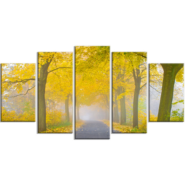 Designart Misty Road in Yellow Autumn Forest Landscape Photography Canvas Print - 5 Panels