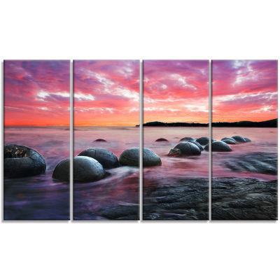 Designart Moeraki Boulders At Sunset Seashore Photo Canvas Art Print - 4 Panels