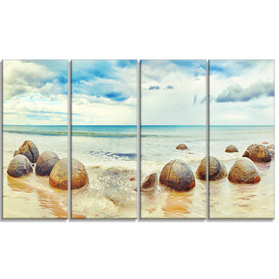 Designart Moeraki Boulders Landscape Photography Canvas ArtPrint - 4 Panels