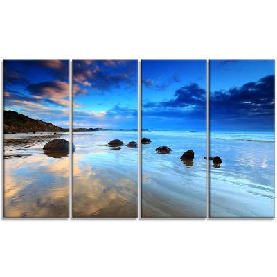 Designart Moeraki Boulders Under Cloudy Sky Seashore Photo Canvas Print - 4 Panels