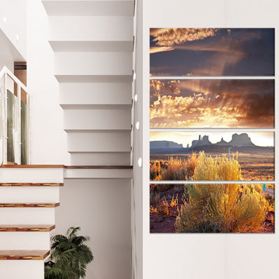 Designart Monument Valley Under Cloudy Sky Oversized AfricanLandscape Canvas Art - 4 Panels