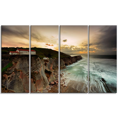 Designart Ocean Hitting Rocky Hill Seashore PhotoCanvas ArtPrint - 4 Panels