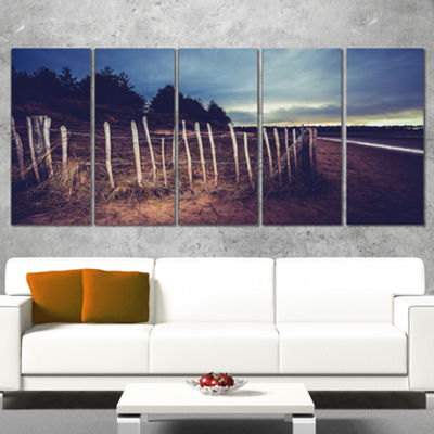 Designart Old Fence on Beach At Sunset Landscape Canvas ArtPrint - 5 Panels