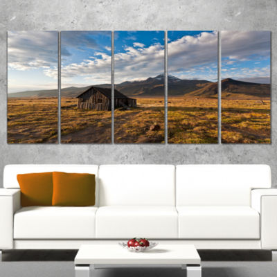 Designart Old House on Kamchatka Island LandscapeCanvas Wall Art - 5 Panels