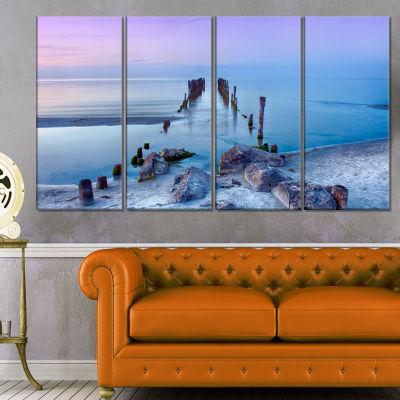 Designart Old Pier and Bridge in Light Blue Sea Bridge Canvas Art Print - 4 Panels
