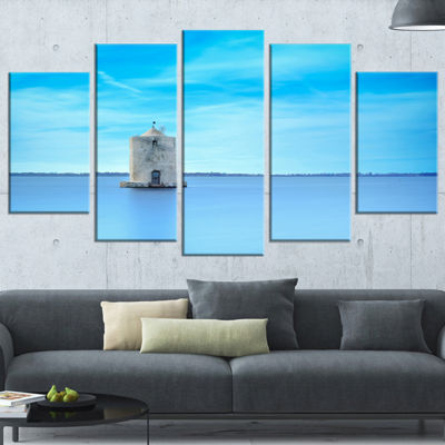 Designart Old Spanish Windmill in Blue Lagoon Extra Large Seashore Wrapped Canvas Art - 5 Panels