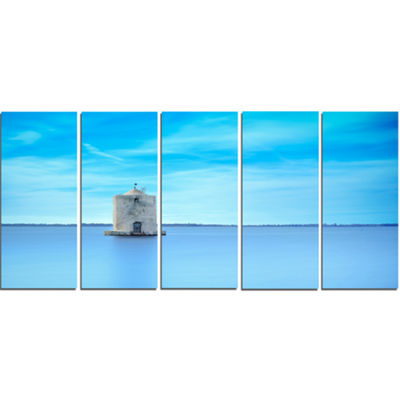 Designart Old Spanish Windmill in Blue Lagoon Extra Large Seashore Canvas Art - 5 Panels