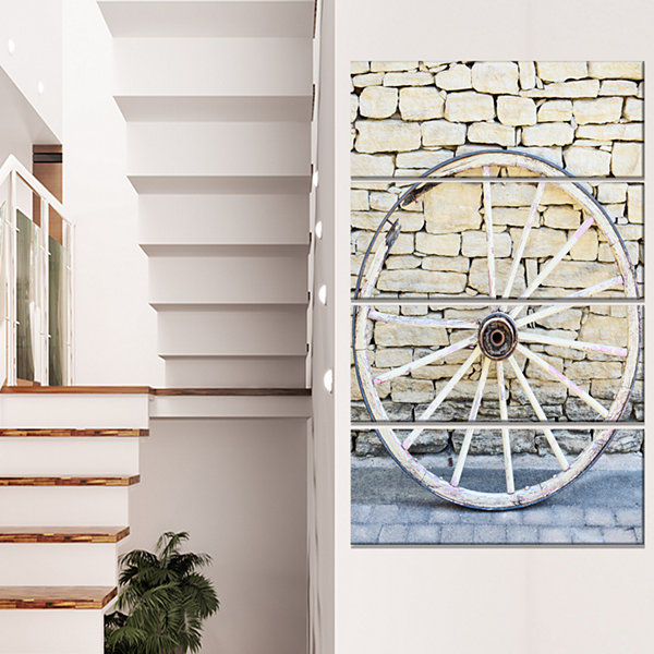 Designart Old Vintage Broken Wood Wheel Extra Large Landscape Canvas Art - 4 Panels