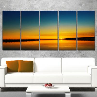 Designart Orange Sunset Over River Skyline Photography Canvas Art - 5 Panels