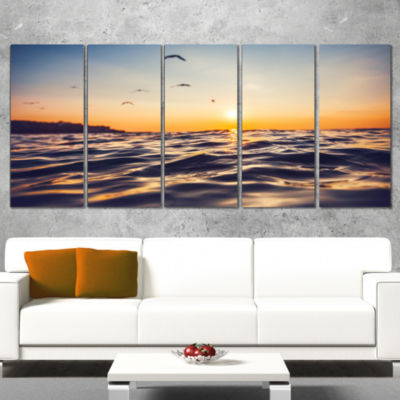 Orange Tinged Sea Waters At Sunrise Beach Photo Canvas Print - 5 Panels