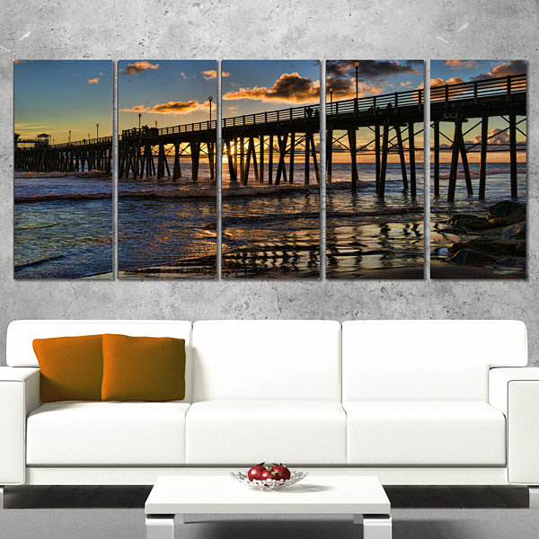 Designart Pacific Ocean Sunset Oceanside Pier Modern Seascape Wrapped Canvas Artwork - 5 Panels