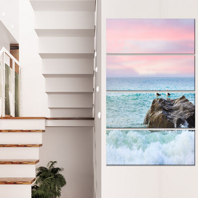 Designart Pair of Seagulls on Large Rock SeascapeCanvas ArtPrint - 4 Panels