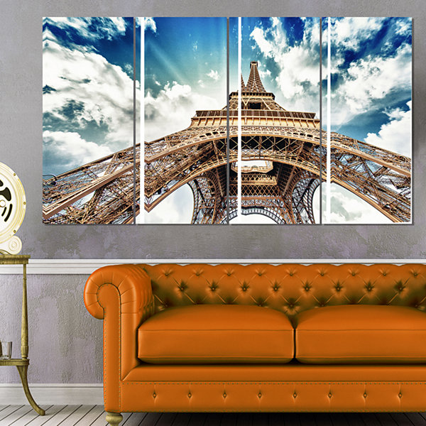 Designart Paris Eiffel Towerwith Fast Moving Clouds Photography Canvas Art Print - 4 Panels