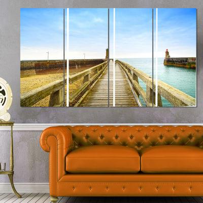 Designart Pier and Lighthouse France Seascape Canvas Art Print - 4 Panels